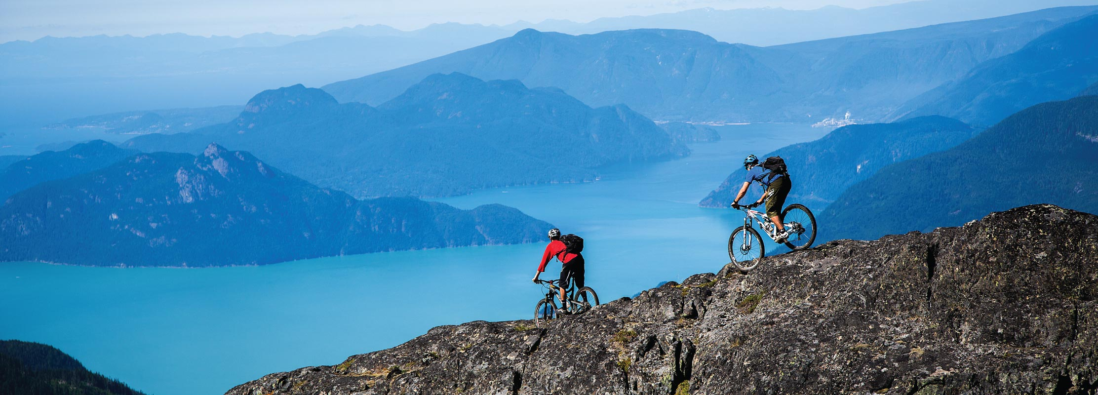Mountain Bikers on Goat Ridge in Squamish, BC